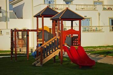 """фото Детская площадка, Отель """"Mitsis Laguna Resort 5*"""", Крит"""